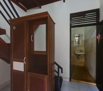 TirtaYogaInn,Double Bedroom with AC - Manggis