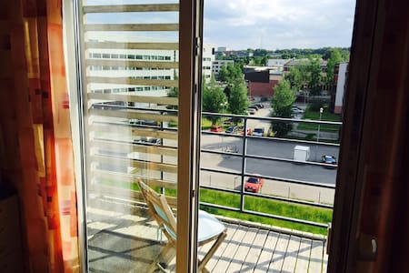Sunny apartment with sauna and view