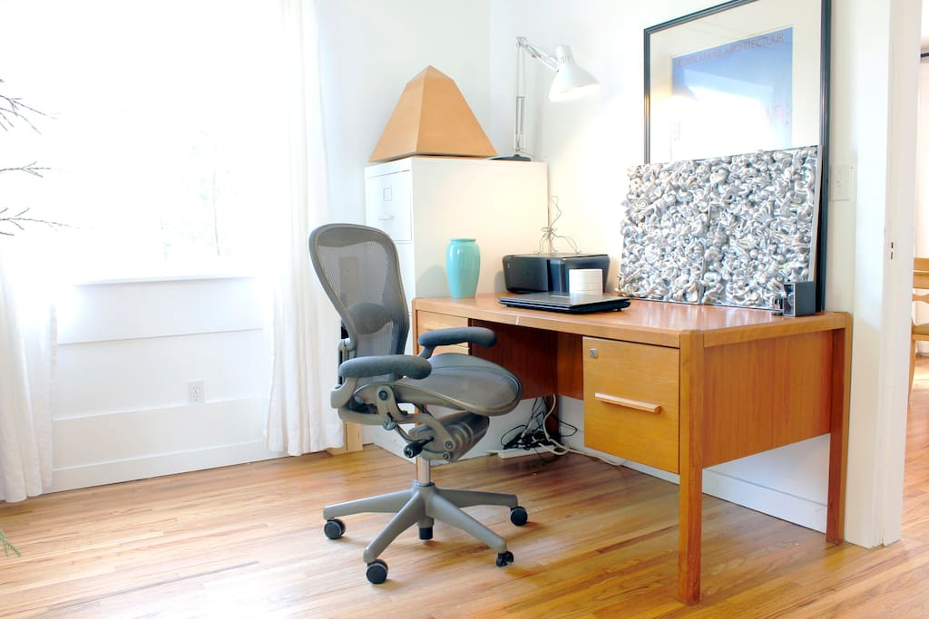 Sorry, but there's plenty of room to work while you're on vacation. The Aeron chair provides hydraulic lift.