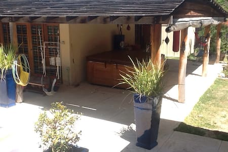 This granny flat/apartment is detached from the main house and has its own entrance so you can come and go as you please.  The unit consists of a main open plan Queen size bedroom with a 2 and 3 seater couch, and includes cooking facilities both inside and out.
