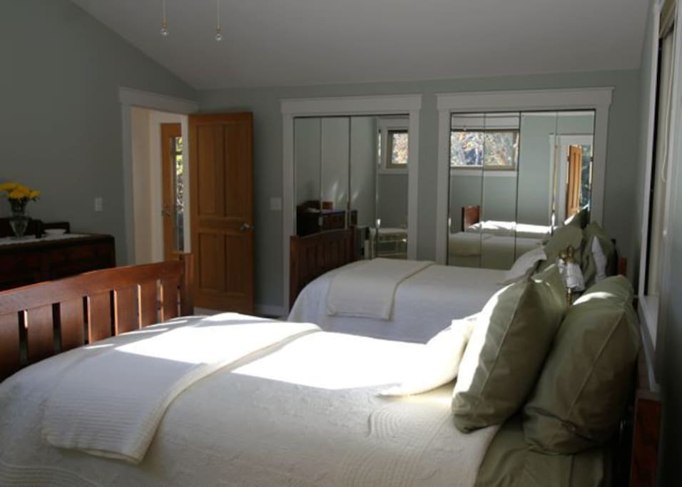 Adjacent bedroom with twin beds, mini refrigerator, microwave & electric kettle