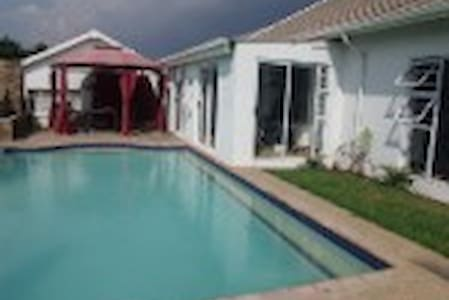 Next to Reading Golf Club a security estate.10 bedroom home suitable for professional business people who travel .Close to all amenities.With pool  braai area.Rooms are different prices and sizes 6 ensuite rooms kingsize and queen beds available.