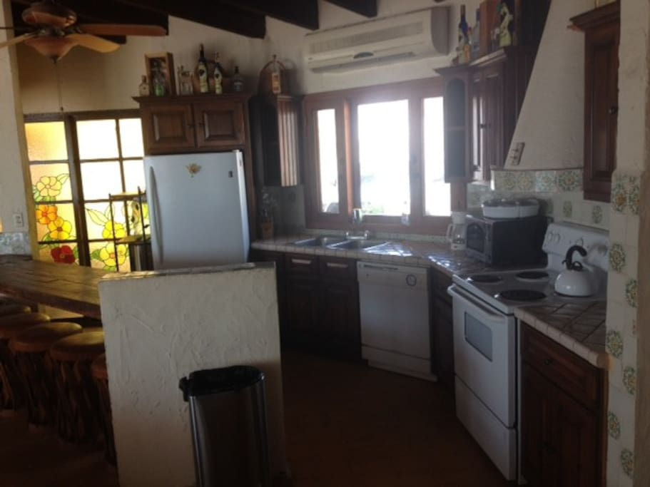 Kitchen area is behind the living room and a great place to hang out and help the cook in the family.  We can provide a chef to cook your meals if you like.  Carmen makes great meals for us and we are sure you will like her cooking as well.