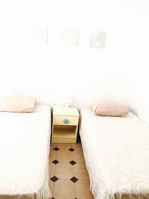 M. 2 Single Beds, Seville Center.