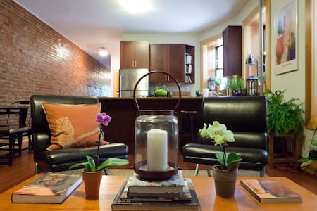 **Brand new listing** Please check my profile for reviews! A spacious newly renovated apartment outfitted with modern luxuries. Exposed brick, elegant furniture, lush greenery & cultural art await you. This urban oasis is sure to heighten your stay