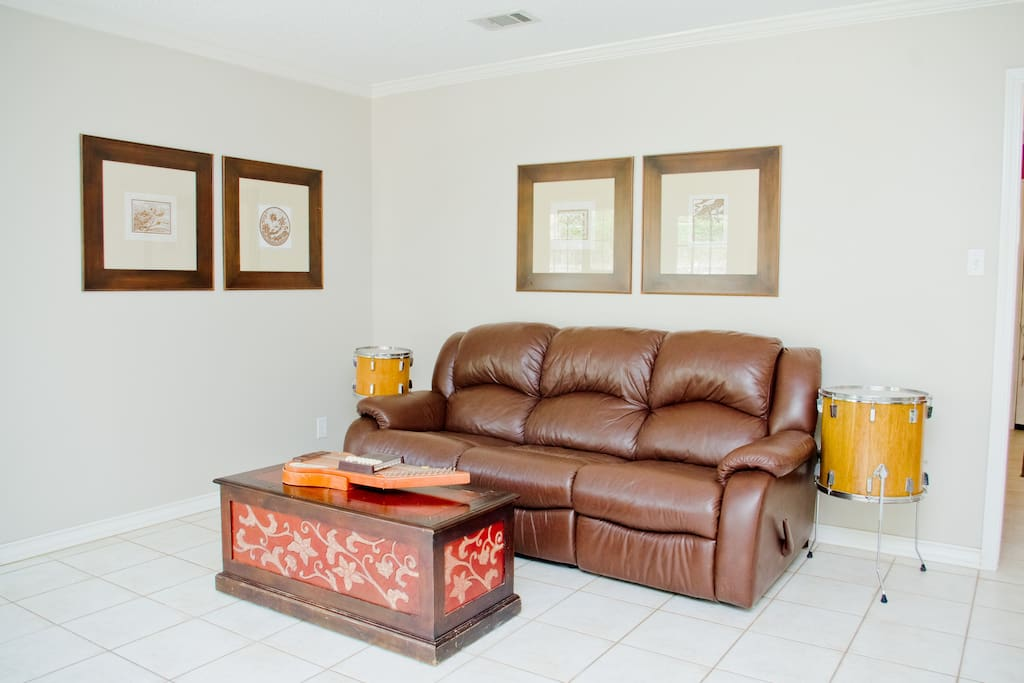 Back living room. There is now a new huge super comfortable couch! New photo pending airbnb photo shoot.
