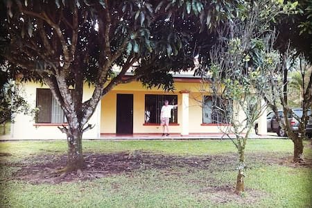 OUR HOUSE is located one of the loveliest areas of Costa Rica - on the way to the La Fortuna waterfall and around the corner from one of the best swimming holes in the entire country. 5 mins. from the center of La Fortuna.