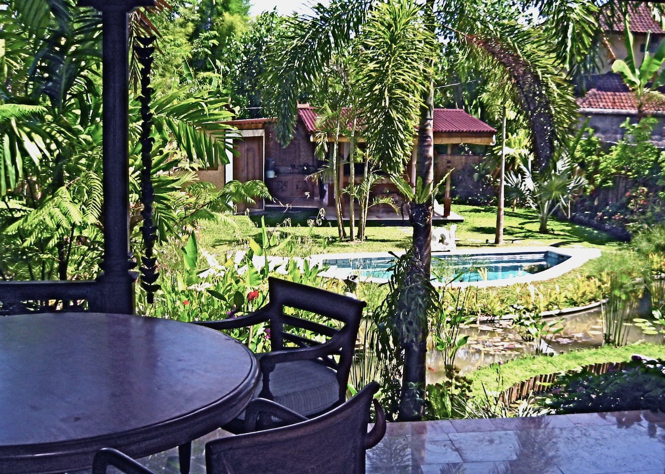 View of Mermaid Pavilion and pool from the Villa Delicious dining table.