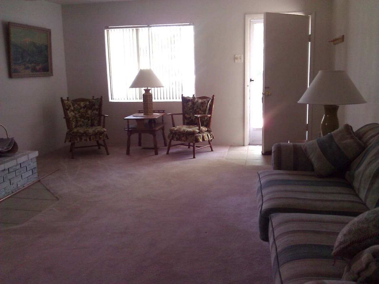 Entry to large living room and comfy place to relax