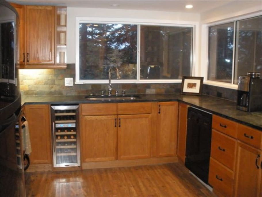 Kitchen with tons of cabinet space and views of the forest