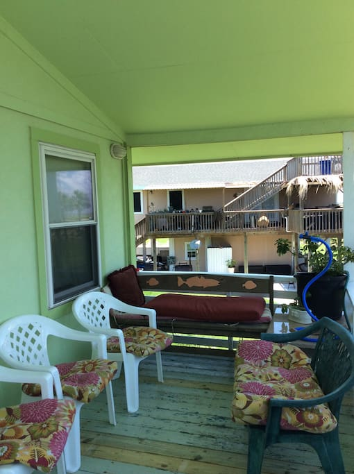 Upstairs covered deck for hanging out and catching sea breezes