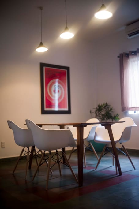 Dining room with large dining/work table.