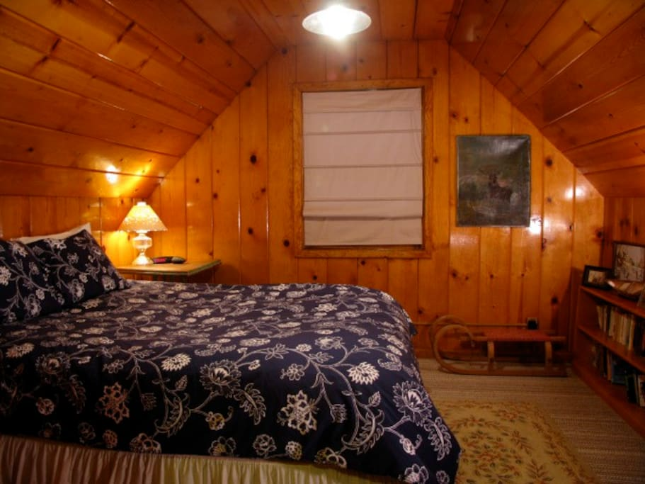 upstairs bedroom with shared bathroom