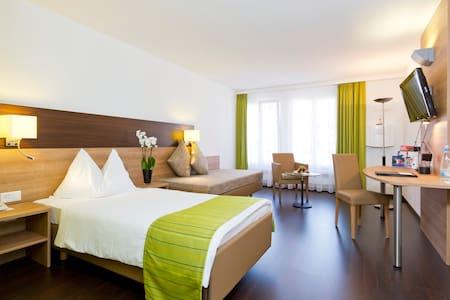 Modernes Zimmer im Herzen von Olten - Condominium