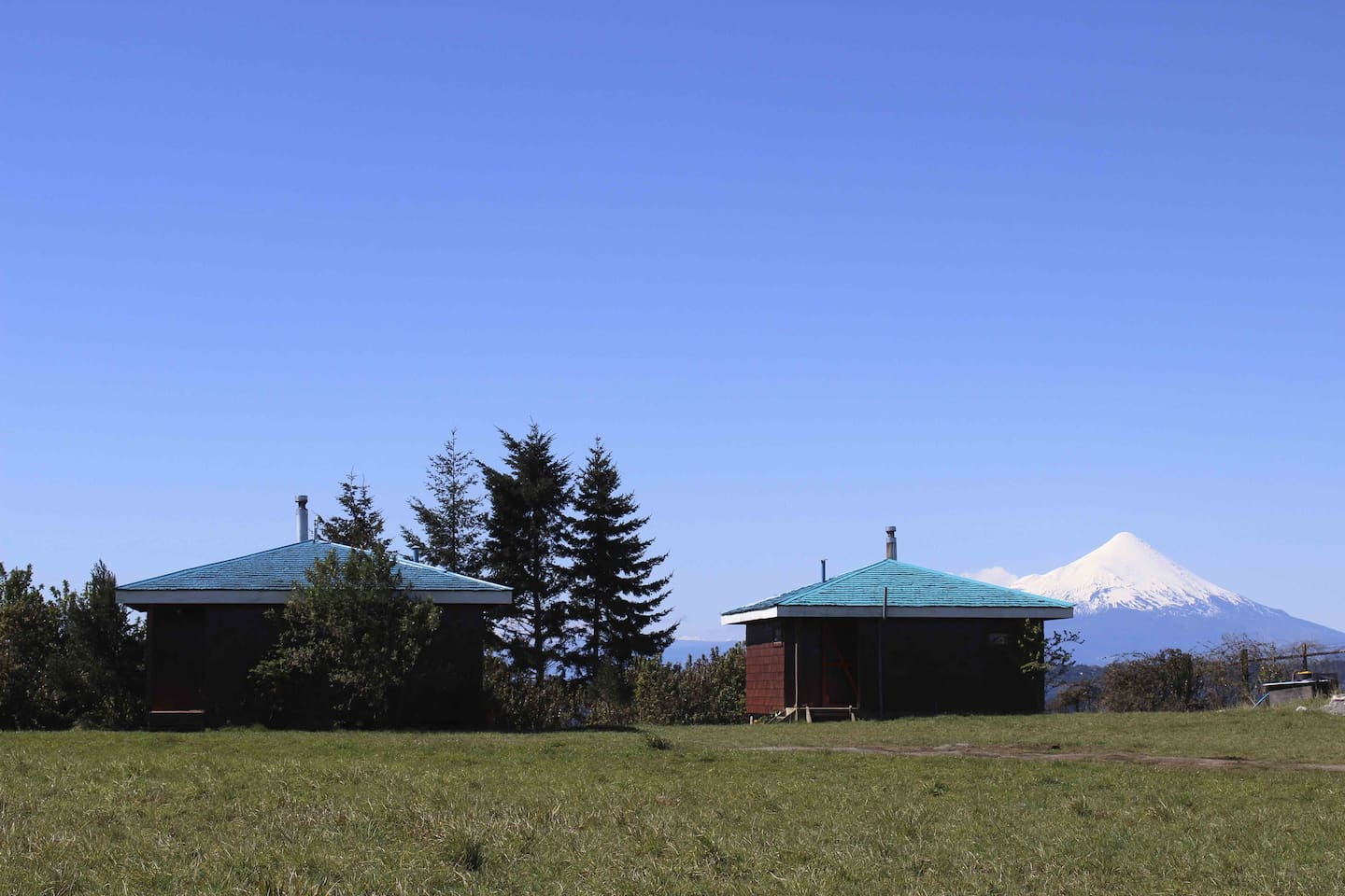 Cabins with beach access on Llanquihue Lake, overlooking Volcano Osorno.