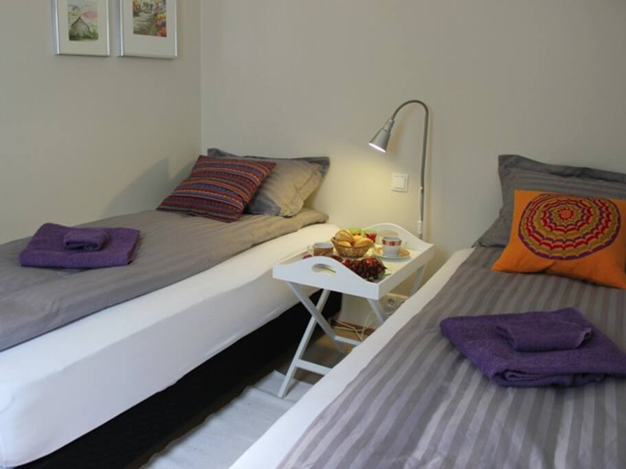 The bedroom has two beds that can be moved into one double bed.
