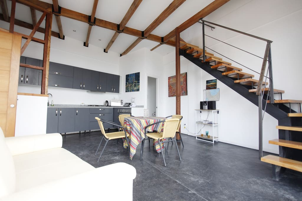 Bright living room with open space kitchen
