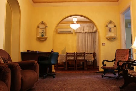 5 min walk from Tahrir square, Nile Corniche, American/Canadian/British embassy & Cairo underground. Our apartment has 4 bedrooms with 2 Queen beds, 2 Twin beds & 1 sofa bed. Fully furnished in a classy way. Kitchen & 2 bathroom just remodeled !!!