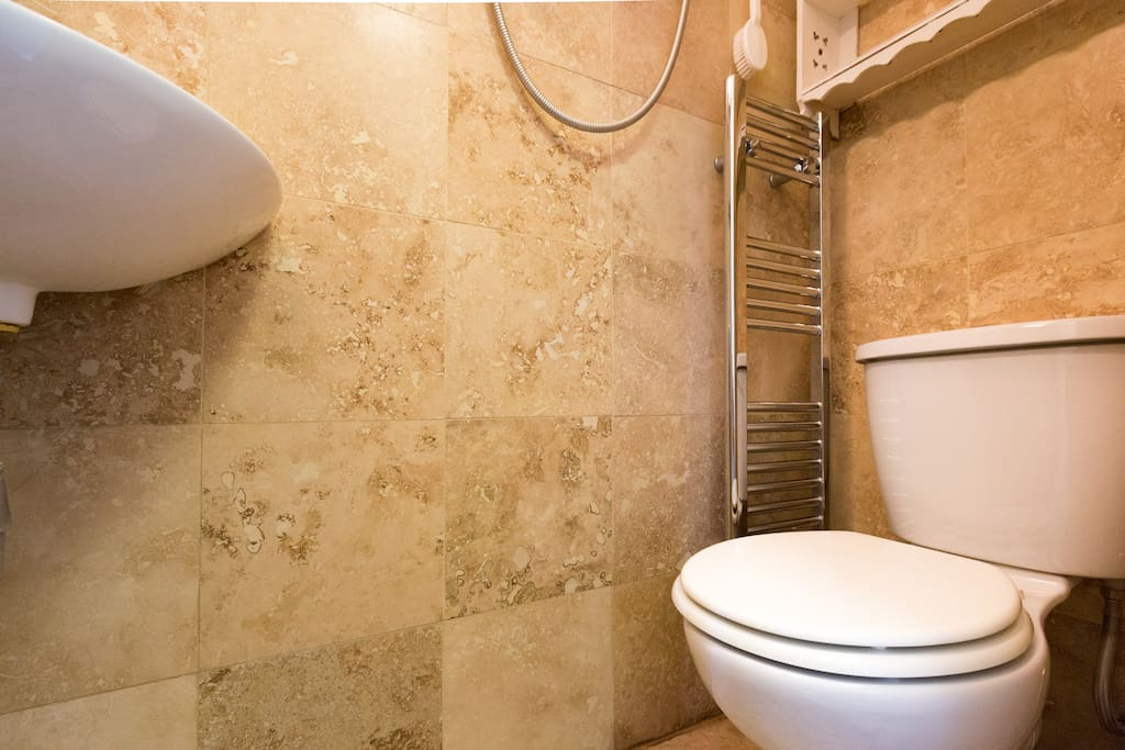 As you see, it is a cubicle style wet-room but very popular and really cute! Not recommended if you are very large or cumbersome,. You could use the shared bathroom on the floor below.When the weather is chilly...a heated towel rail....Nice in the winter!