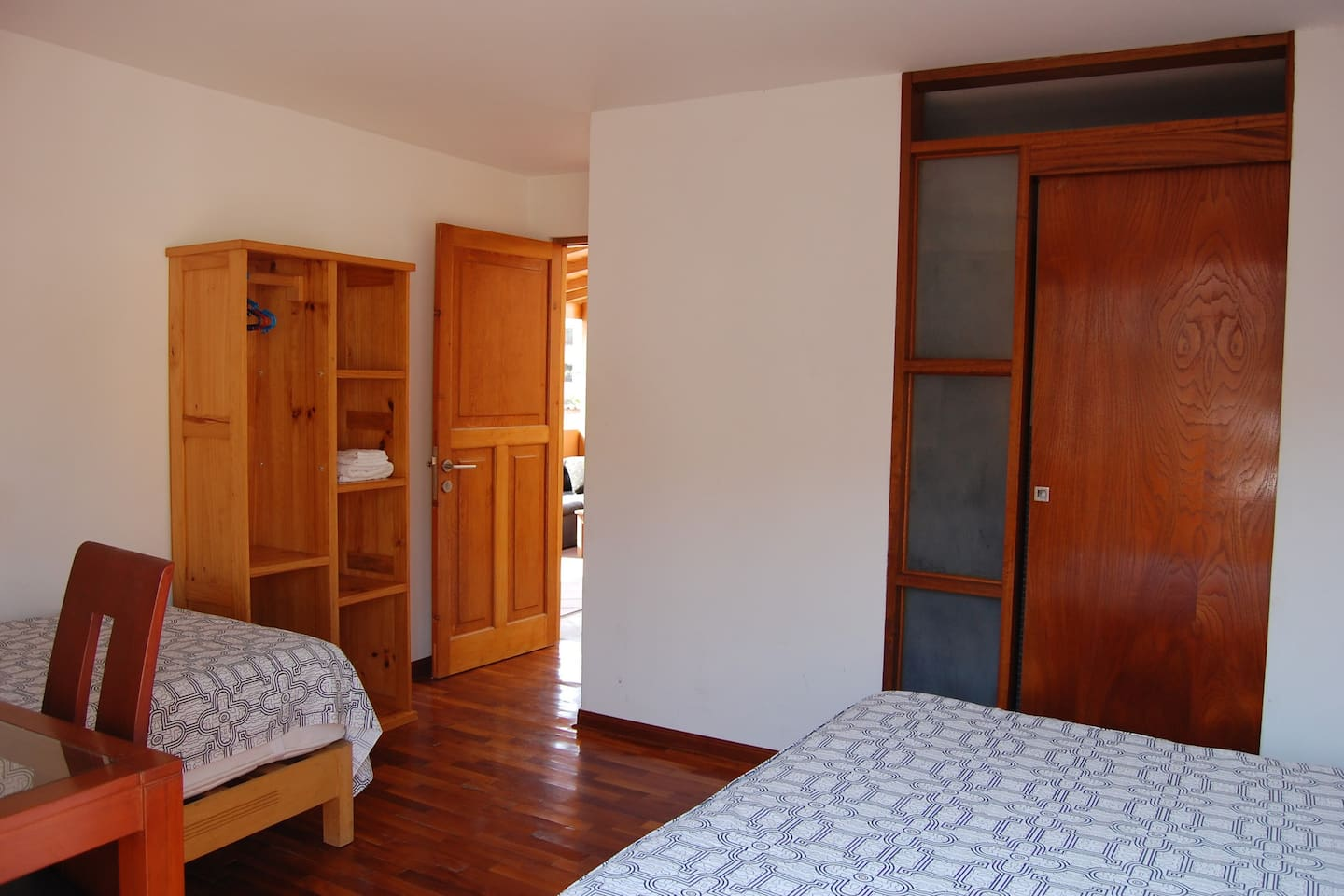 Room 2 - Queen bed and single bed.