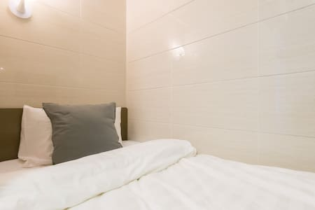'Inn Square' provides a SINGLE BED and a private bathroom room. We provides a comfy and tidy place at an affordable rate for travelers. The room size is 80 sqf. Quiet and comfy sleeping condition is guaranteed.