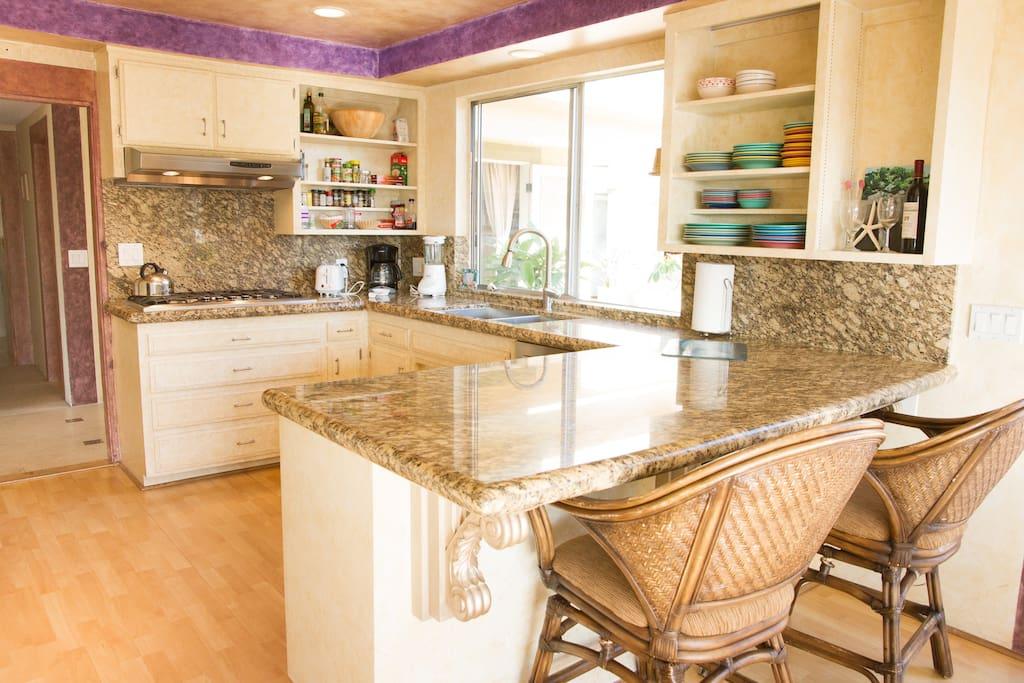 Travertine counter tops in kitchen