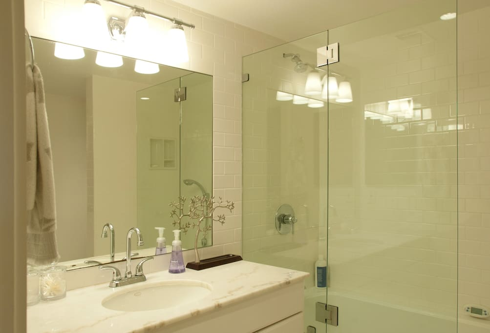 Private bathroom with shower/whirlpool tub