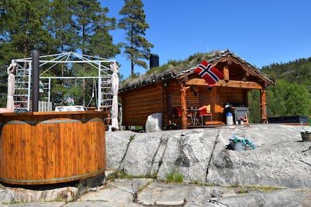 Hytte med badestamp og kos - marnadal