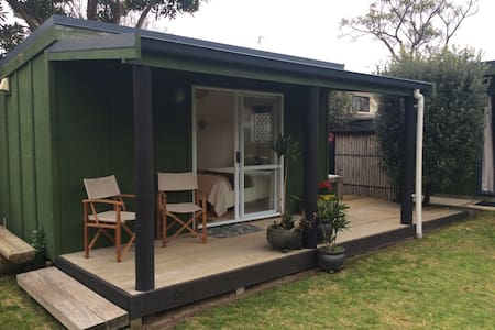 Beach Bungalow Papamoa is situated across the road from the golden sands of Papamoa Beach.  A stand alone bungalow very clean, bright and sunny with bathroom on suite, deck and outside bath.  Separate lounge, off street parking.