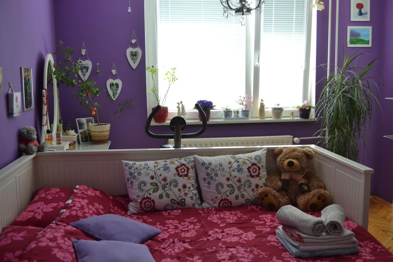 Violet room for 2 guests.
