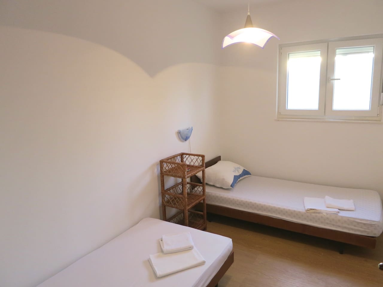 This nice and clean room has two individual beds and its own bathroom