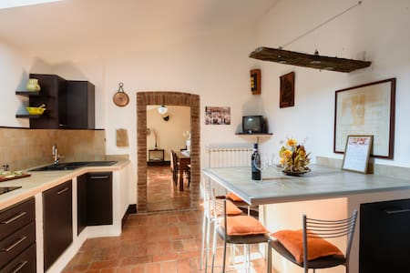 The apartment is located at the second floor of an historic building overlooking the Piazza Grande, the main square of Montepulciano.  The  apartment is lightning, quiet,  spaceaus  with view of the valley and the lakes from the windows.