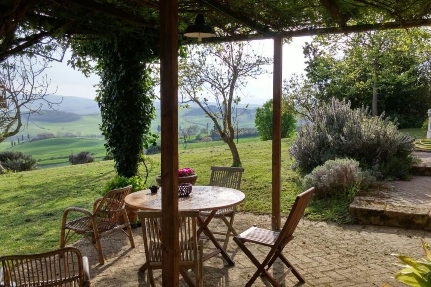 Pergola with table and chairs