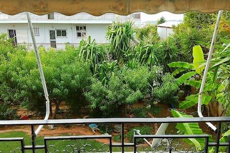 Spacious Apartment with Tropical Garden View - Voula