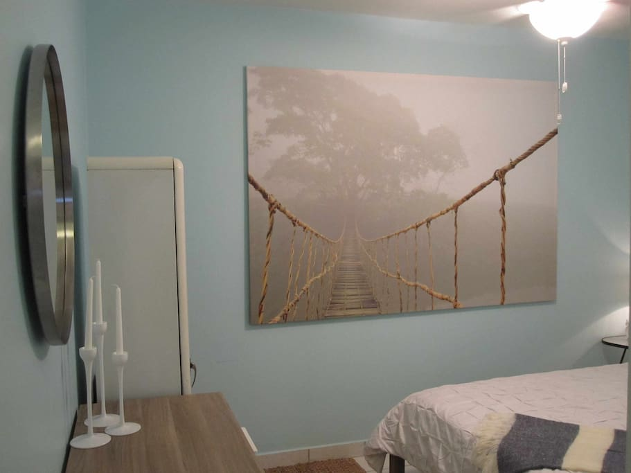 Art and cupboards in the bedroom
