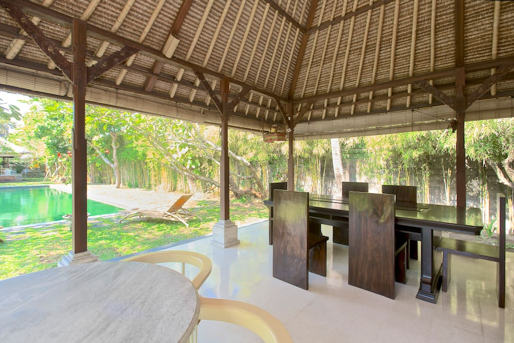 Breakfast table and chairs (breakfast not included) from balé looking towards pool.