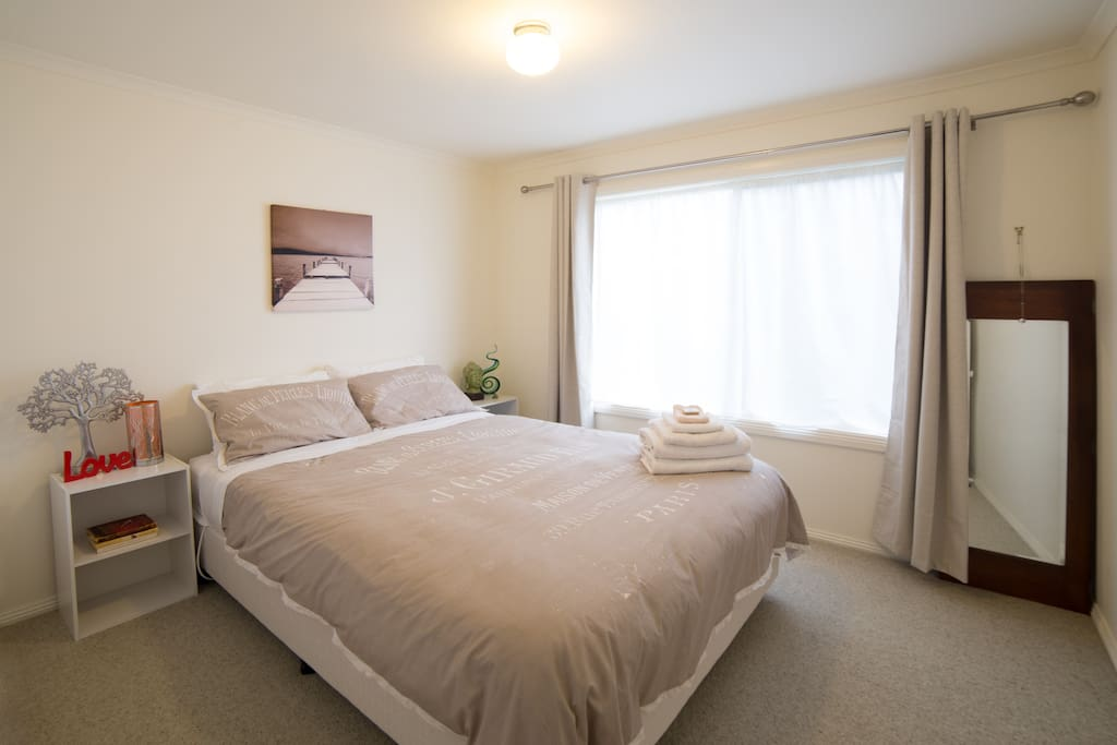 Spacious and peaceful bedroom with extremely comfortable queen bed for a restful night's sleep