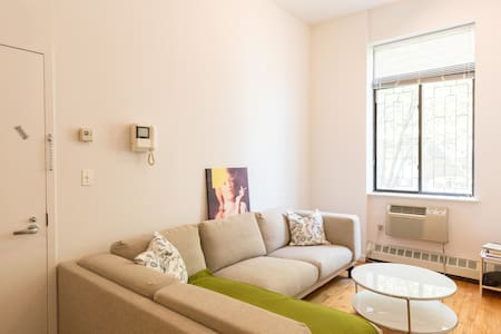 This well equipped and spacious studio has high ceilings, an elevated bed, full service kitchen with island table, living room with large sectional sofa and a large bathroom. It's right in the heart of Alphabet City close to many attractions.