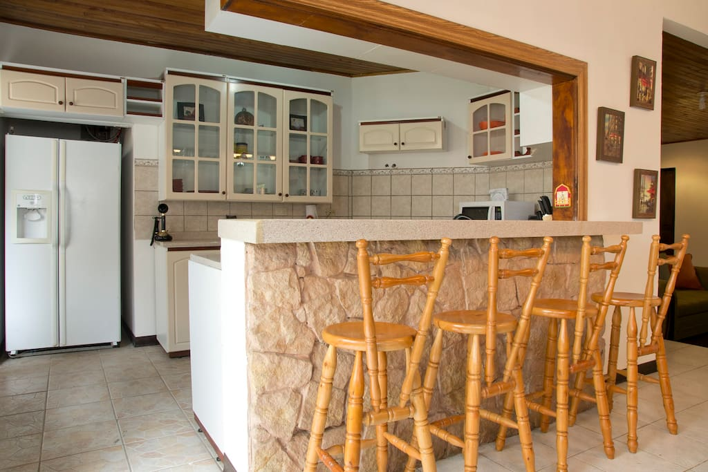 Breakfast bar, next to the full and large dining room table