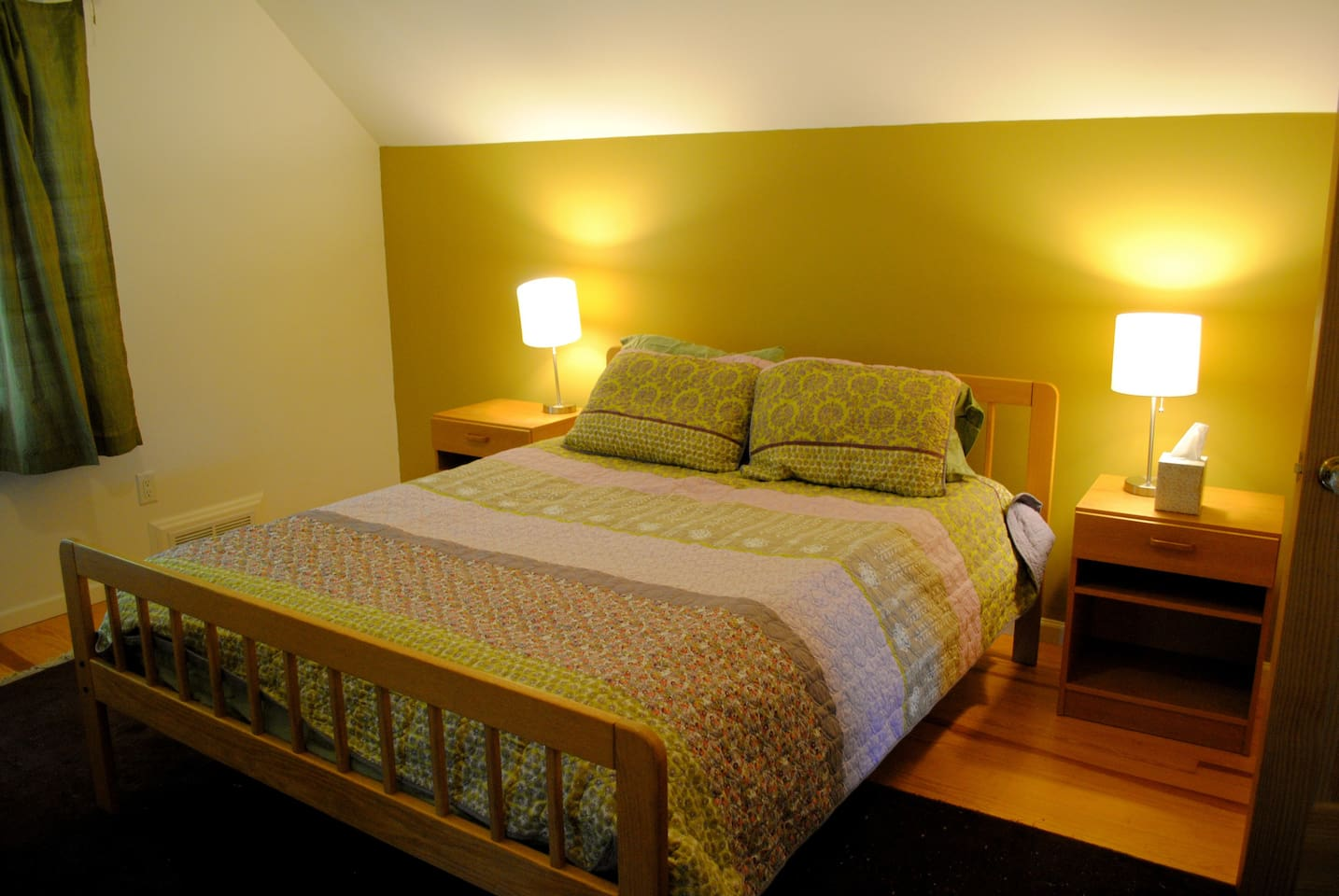 your cozy room with queen size bed is all ready for you, with a full size futon bed in an alcove.