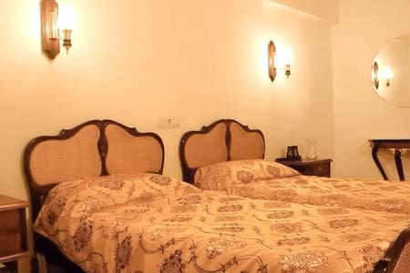 The room is pleasantly decorated and is equipped with bathroom ensuite, fridge, mirrors and ample wardrobe space.