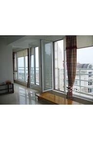 伴月湾高层海景舒适度假二居公寓,带车位 - 威海市 - Wohnung