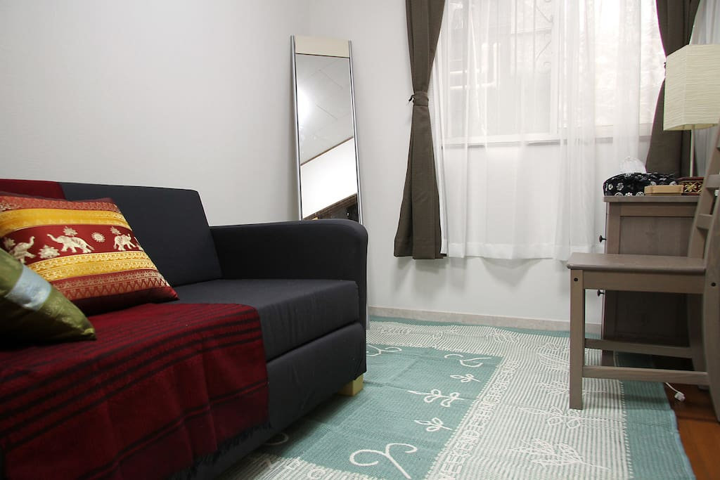 Asian style bedroom with a semi-double sofa bed
