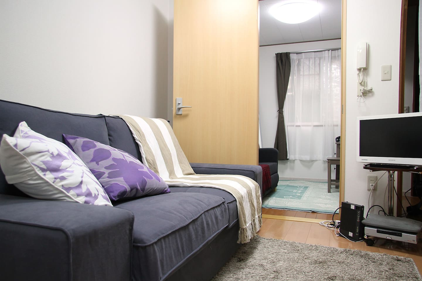 Comfortable living room with TV, DVD Player, Books, etc