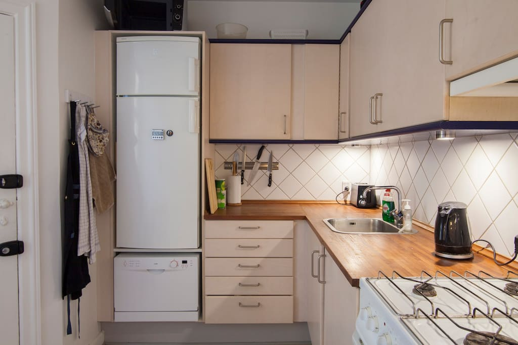 Kitchen with microwave, dishwasher, stove, oven etc.