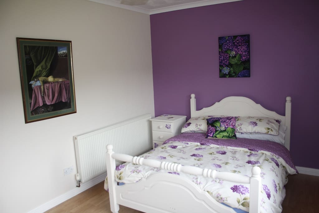 Spacious bedroom with a comfy double bed.