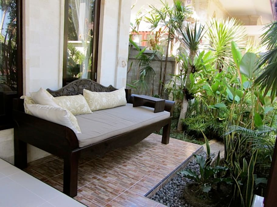 An outdoor daybed welcomes you to a daytime nap in the shade.