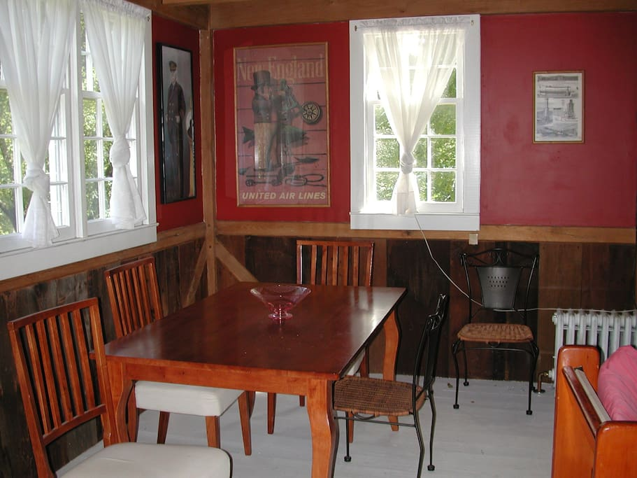 Dining side of the main room, couch and wood stove are to the right.