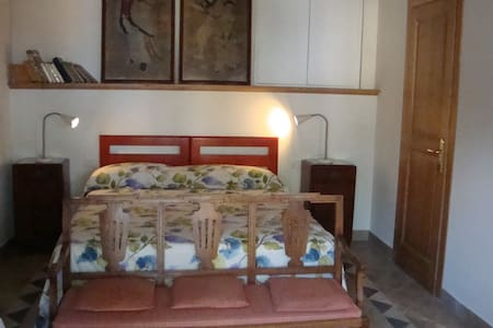 La Porticella room with bathroom and kitchenette - House