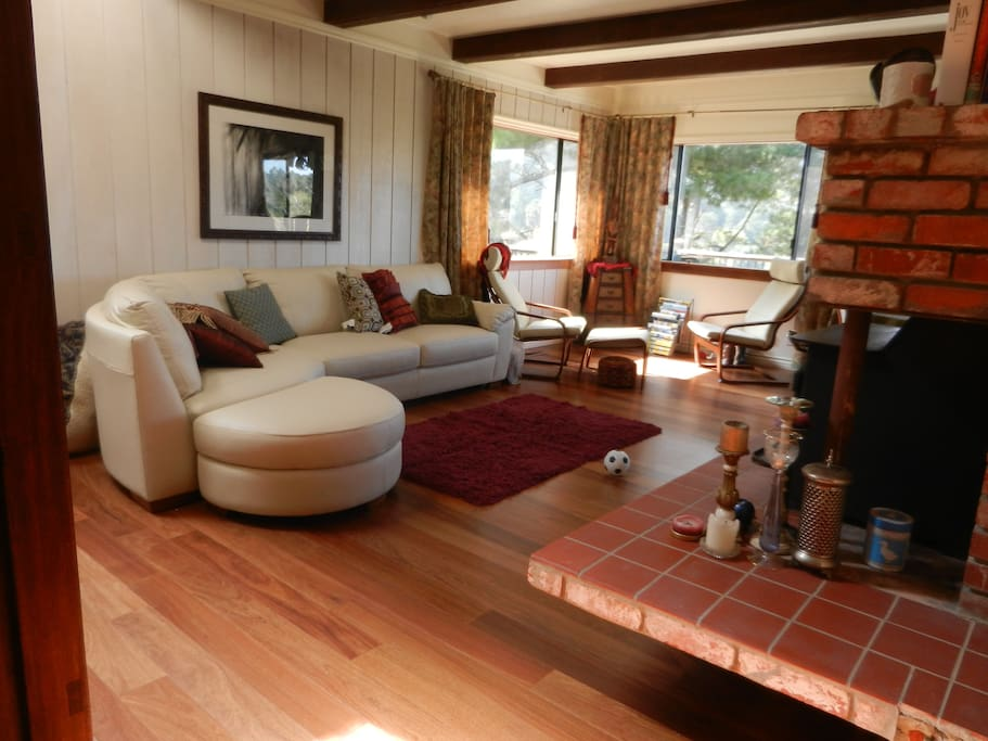 Main level Living room with grand views of the Marin Headlands. Walk to the overlook for sunset or choice of 2 beaches.